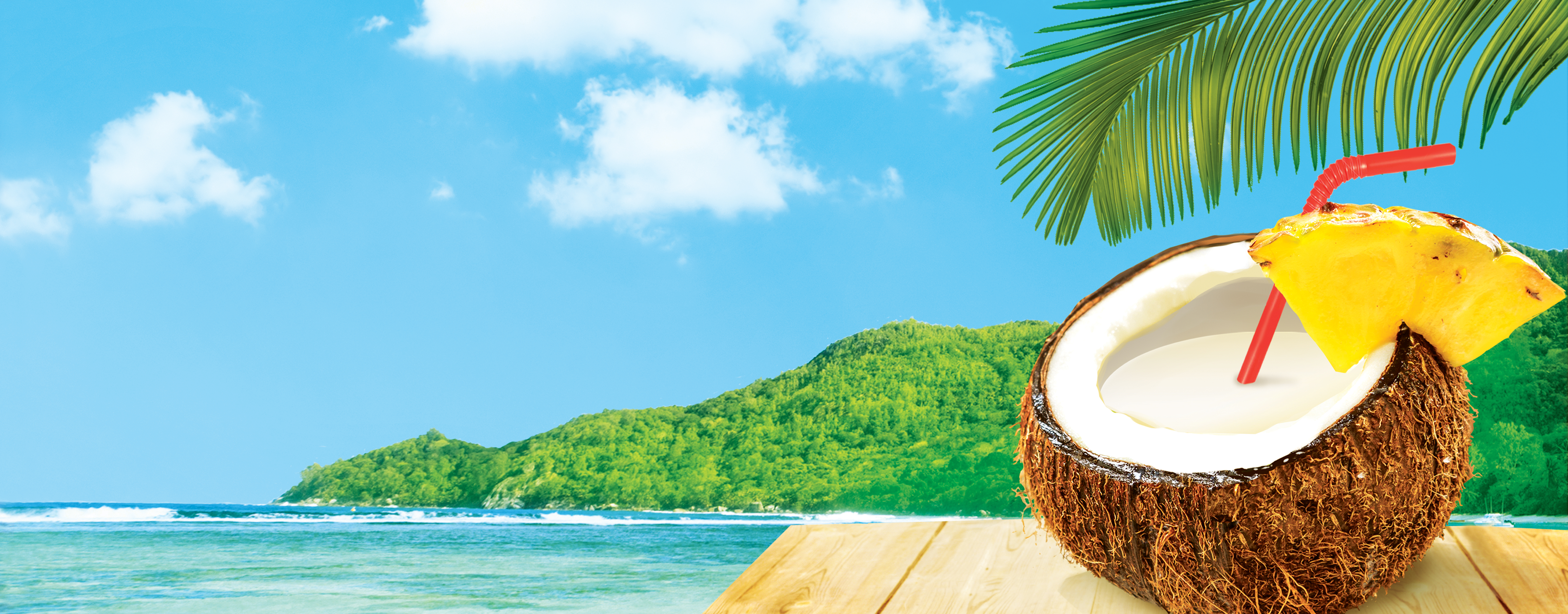 coconut with a straw sitting on table with beach scene behind