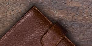leather wallet on wood surface
